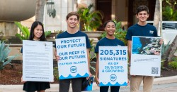 Cayman Students present a global anti-dredging petition to Royal Caribbean President
