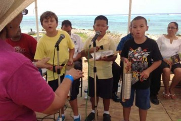 Students from the Little Cayman School Performs for the attendees of the Little Cayman 2014 Agriculture Show.