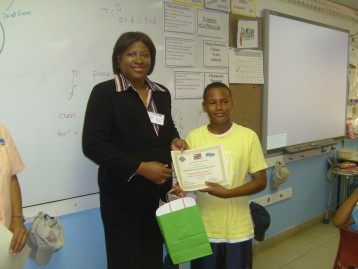 Director Norma McField & a student participant in an Earth Day PSA writing competition