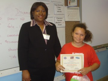 Director Norma McField & a participant in the station's Earth Day PSA writing competition